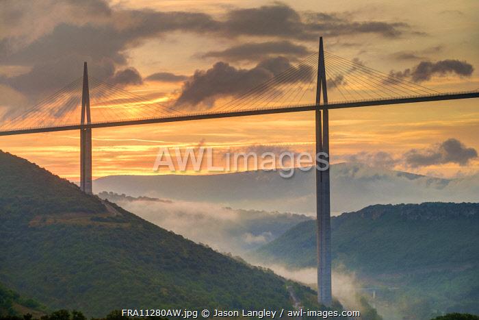 Viaduc de Millau bridge over Tarn river valley at sunrise, Millau, Aveyron Department, Midi-Pyrénées, France