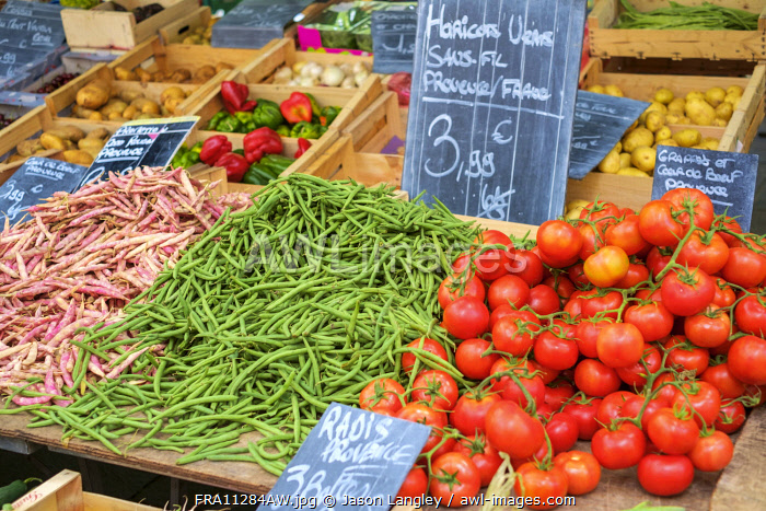 Fresh vegetables for sale in farmer's market on Place aux Herbes in Uzès, Gard Department, Languedoc-Roussillon, France