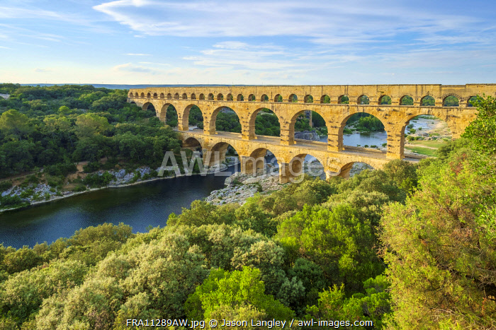 Pont du Gard Roman aqueduct over Gard River in late afternoon, Gard Department, Languedoc-Roussillon, France