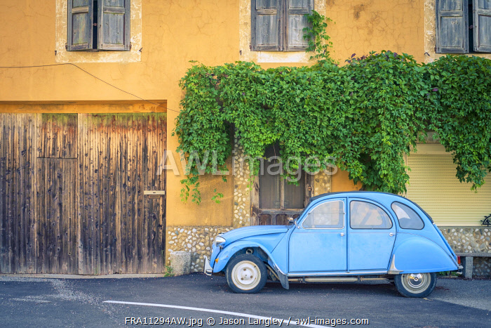 Vintage blue Citroën 2cv parked in front of a house in Castellet, Vaucluse, Provence-Alpes-Côte-d'Azur, France
