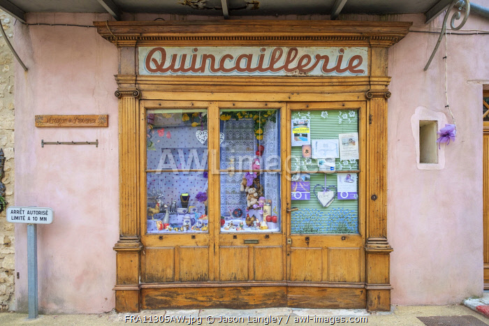 Old façade of hardware store with pained sign for 'Quincaillerie', Sault, Vaucluse, Provence-Alpes-Côte d'Azur. France