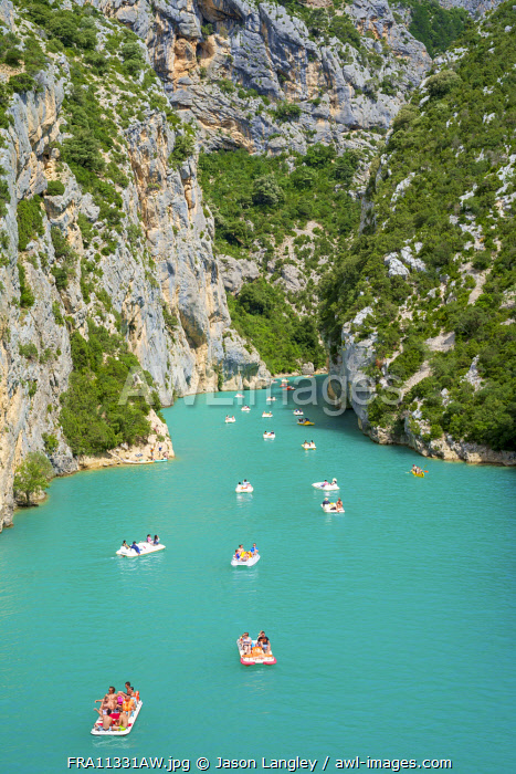 People in paddleboats at the entrance of the Gorge du Verdon on Lac de Sainte-Croix, Var/Alpes-de-Haute-Provence, Provence-Alpes-Côte d'Azur, France