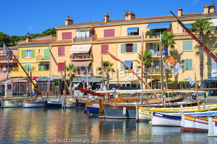 Port harbor filled with traditional wooden fishing boats at Sanary-sur-Mer, Var department, Provence-Alpes-Côte d'Azur, France