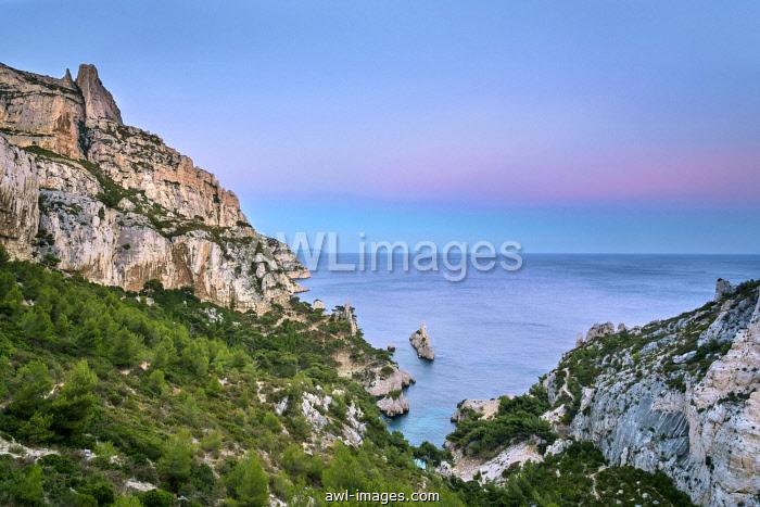 Mediterranean landscape at Calanque de Sugiton after sunset, Parc National des Calanques, Provence-Alpes-Côte d'Azur, Bouches-du-Rhône, France