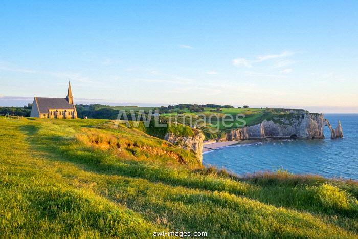 France, Normandy (Normandie), Seine-Maritime department, Etretat. Chapelle Notre-Dame de la Garde chapel and white chalk cliffs.