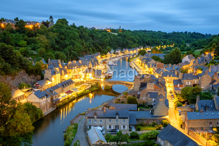 France, Brittany (Bretagne), Côtes-d'Armor department, Dinan. Dinan Harbor on the Rance River at dusk.