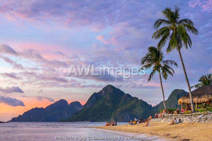 Las Cabanas Beach Resort on Marimegmeg Beach at sunset, El Nido, Palawan, Philippines