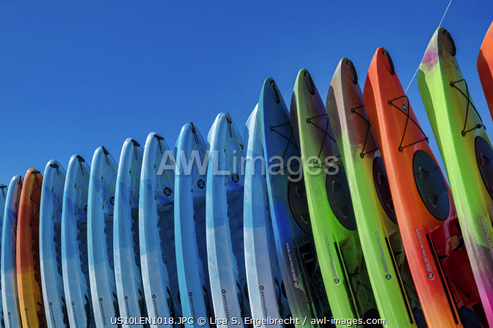 Stacked kayaks on a beach, Florida, USA
