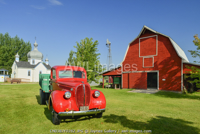 awl-images.com - Canada / Canada, Manitoba, Portage La Prairie. Old truck and barn at Fort la Reine Museum