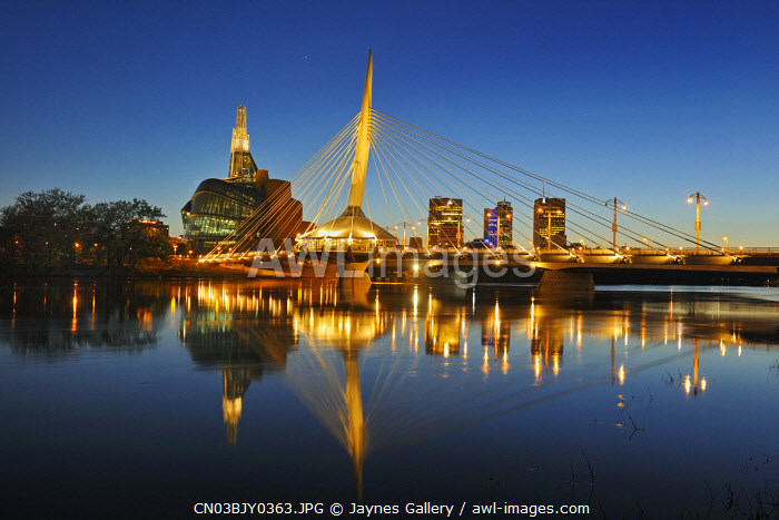awl-images.com - Canada / Canada, Manitoba, Winnipeg. Red River and city skyline at sunset