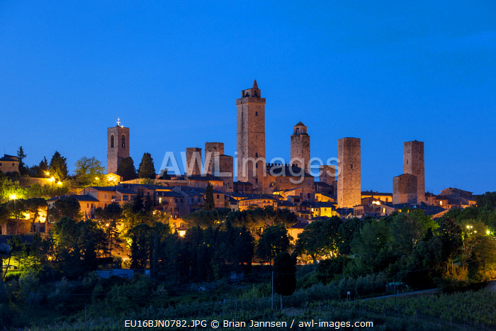 Twilight over the towers and medieval town of San Gimignano, Tuscany, Italy