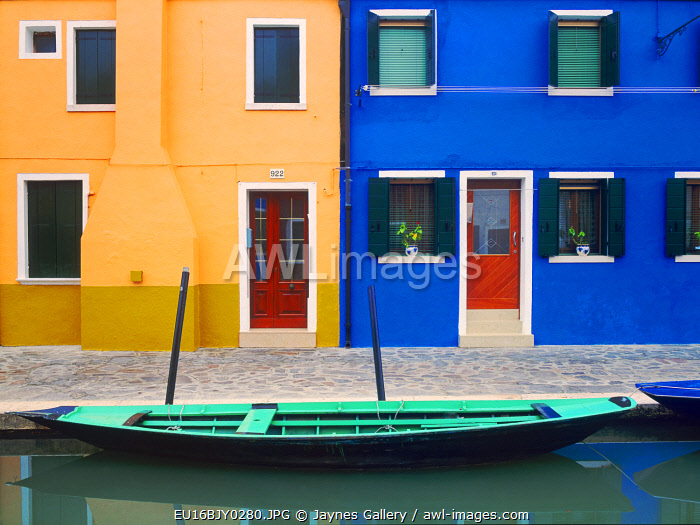 Italy, Burano. Colorful house exteriors and boat in canal