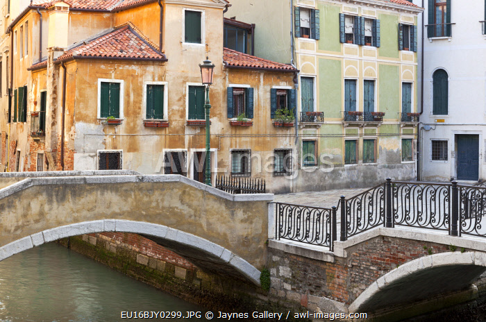 Italy, Venice. Canal bridge and building