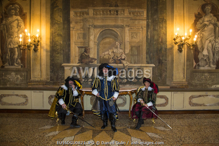 Venice, Italy. Carnival participants dressed as Three Musketeers in old Palace