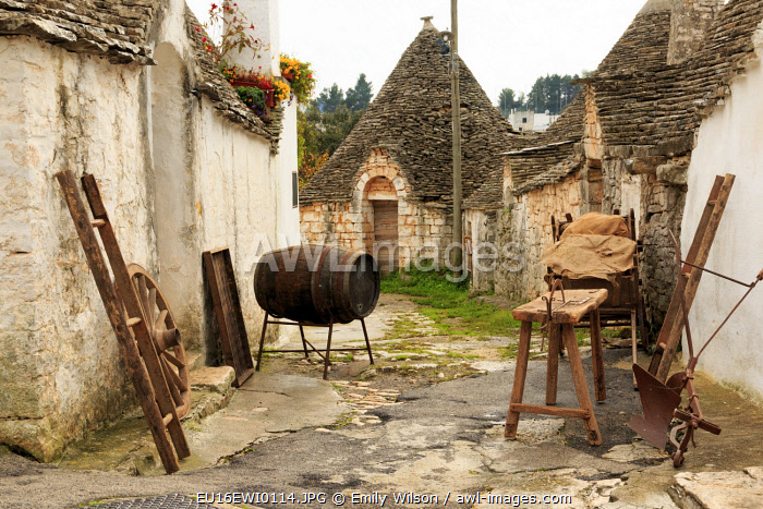 Italy, Region of Apulia, Province of Bari, Itria Valley, Alberobello. A trullo house is an Apulian dry stone hut with a conical roof, UNESCO Heritage Site.