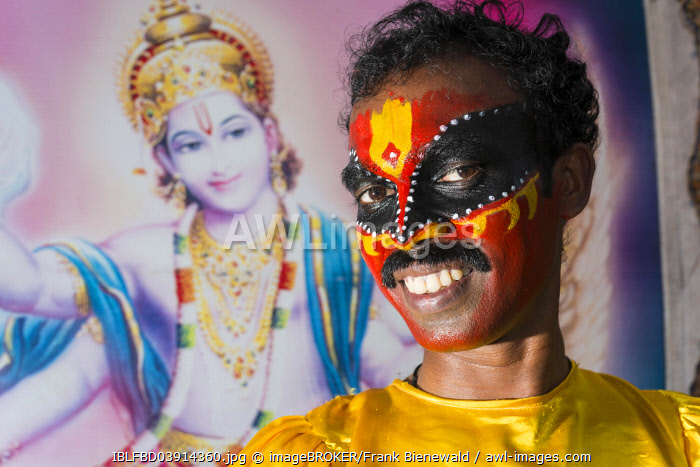 An artist with the complete make up of the character Garuda for the procession during a temple festival, Ayroor, Kerala, India, Asia