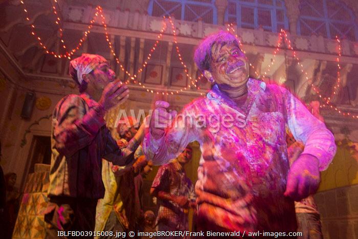 Devotees covered in coloured powder celebrating, Holi festival, Banke Bihari Temple, Vrindavan, Uttar Pradesh, India, Asia