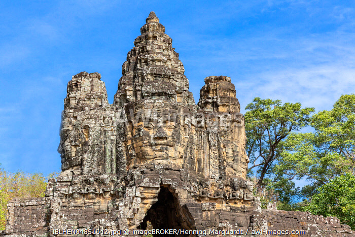 Carved faces on South Gate of Angkor Thom, Siem Reap, Cambodia, Asia