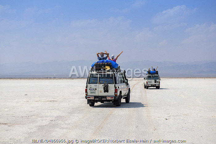 Jeep tour with tourists over Lake Karum, Danakil Desert, Ethiopia, Africa