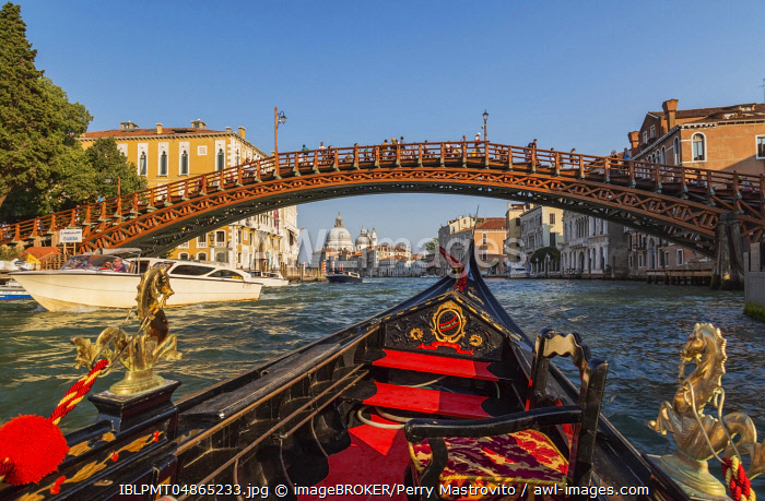 View from gondola to Accademia wooden footbridge over Grand canal, in the back Santa Maria della Salute basilica, Venice, Veneto, Italy, Europe
