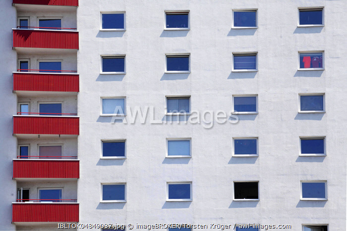 Red balconies and windows on a white residential building, monotonous house facade, Bremerhaven, Bremen, Germany, Europe