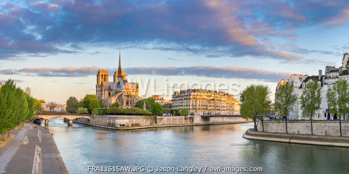 Notre Dame Cathedral on the banks of the Seine River at sunrise, Paris, France