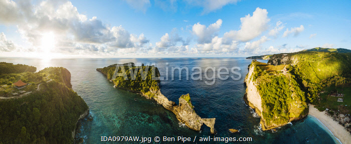awl-images.com - Indonesia / Aerial View of Sunrise over Batupadasan, Klungkung, Nusa Penida, Bali, Indonesia