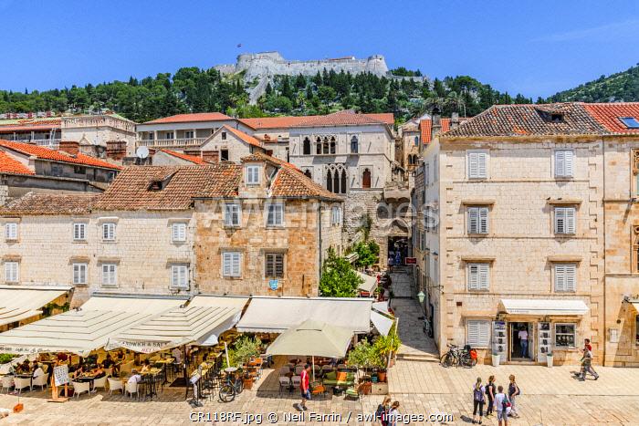 Restaurants and Hvar Fortress, Hvar Town, Hvar, Dalmatian Coast, Croatia, Europe