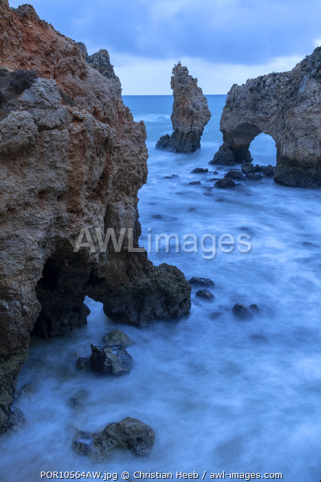 awl-images.com - Portugal / Portugal, Algarve, Lagos, Sea stacks and arch on coast