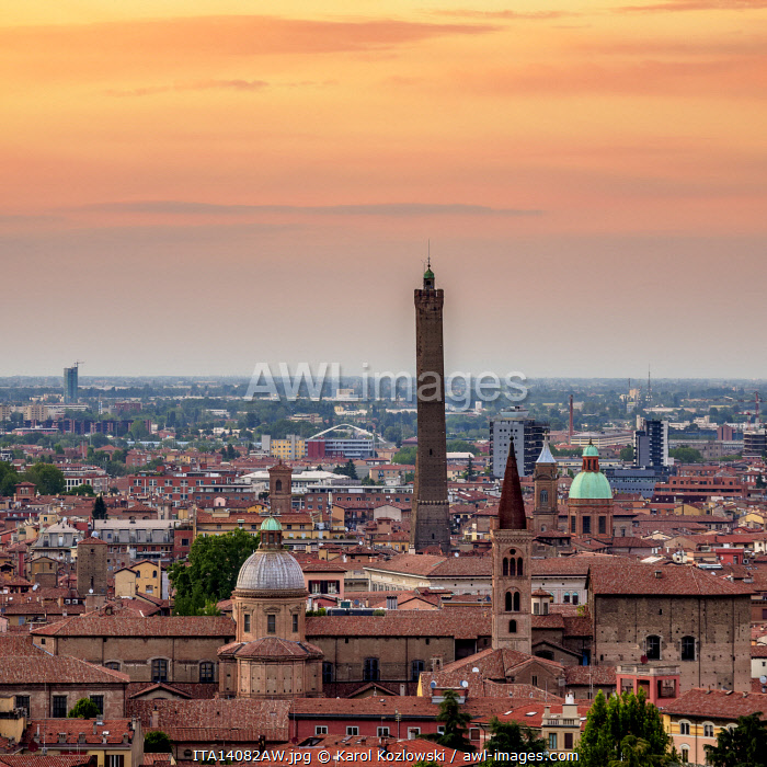 Cityscape with San Domenico Basilica and Asinelli Tower at sunset, elevated view, Bologna, Emilia-Romagna, Italy