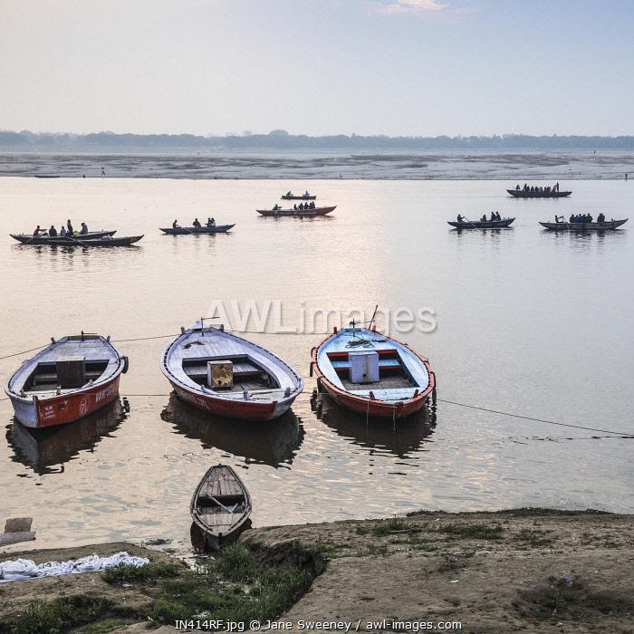 India, Uttar Pradesh, Varanasi, People doing laundry on banks of Ganges River