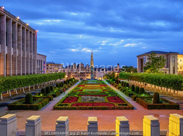 View over Mont des Arts Public Garden towards Town Hall Spire at dusk, Brussels, Belgium