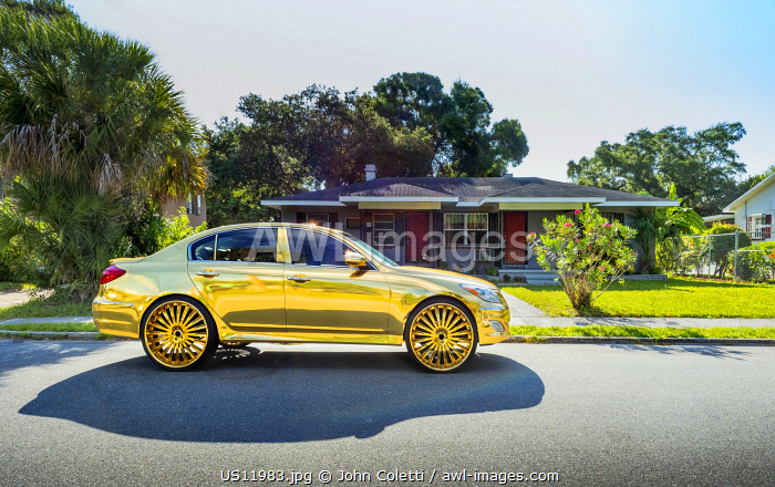 USA, Florida, Saint Petersburg, Big Wheel Custom Gold Car, African-American Neighborhood, Cultural Phenomenon