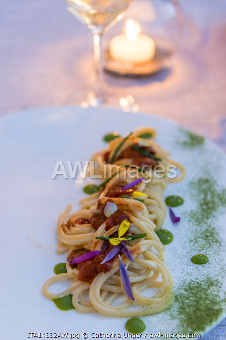 Europe, Italy, Tuscany. A plate with sea food spaghetti served in a restaurant on the Monte Argentario