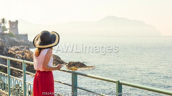 Europe, Italy, Liguria. On the promenade Anita Garibaldi in Genoa Nervi watching towards the Portofino promontory.