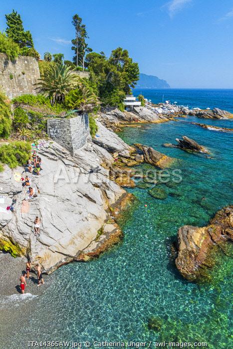 Europe, Italy, Liguria. Genoa, Nervi. Kids having fun on the rocks of Nervi.