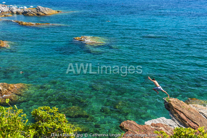 Europe, Italy, Liguria. Genoa, Nervi. Kids having fun on the rocks of Nervi.