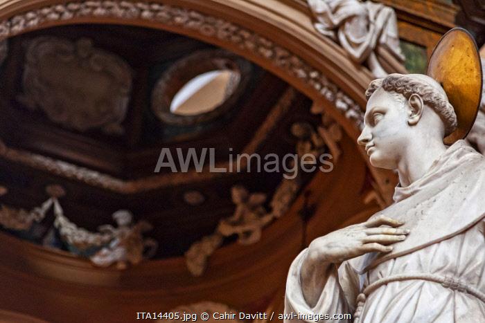 Interior of the Basilica di San Petronio with statue in the forecround, Piazza Maggiore, Bologna, Emilia Romagna, Italy.