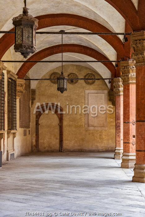 Architectural detail of the courtyard arcade in the Palazzo d'Accursio (Palazzo Comunale), PIazza Maggiore, Bologna, Emilia Romagna, Italy.
