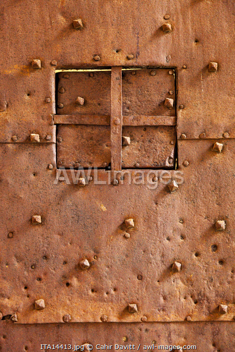 Architectural detail of an iron door and viewing hatch in the Palazzo d'Accursio (Palazzo Comunale), PIazza Maggiore, Bologna, Emilia Romagna, Italy.