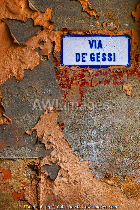Street sign on old wall on the Via de Gessi, Bologna, Emilia Romagna, Italy.
