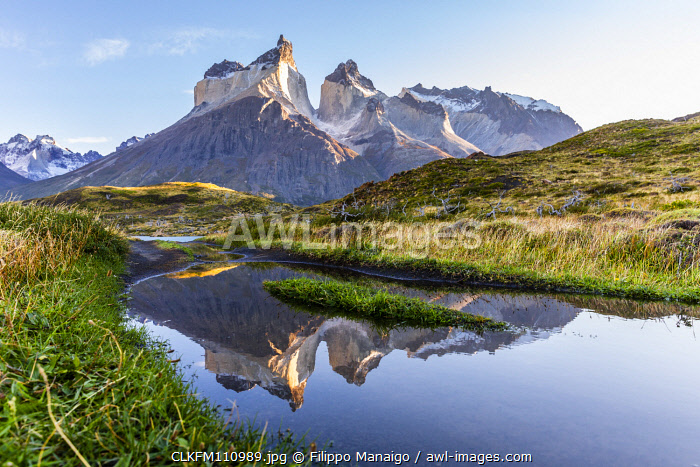 awl-images.com - Chile / Chile, Patagonia, Magallanes and the Chilean region of Antarctica, Ultima Esperanza province, Torres del Paine national park,the Paine Horns reflected in a puddle