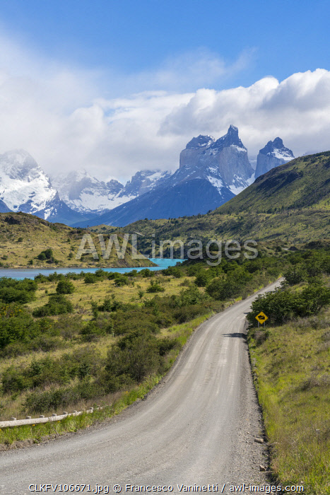 awl-images.com - Chile / Dirt road and Lake Pehoé and Paine Horns in the background, in summer. Torres del Paine National Park, Ultima Esperanza province, Magallanes region, Chile.