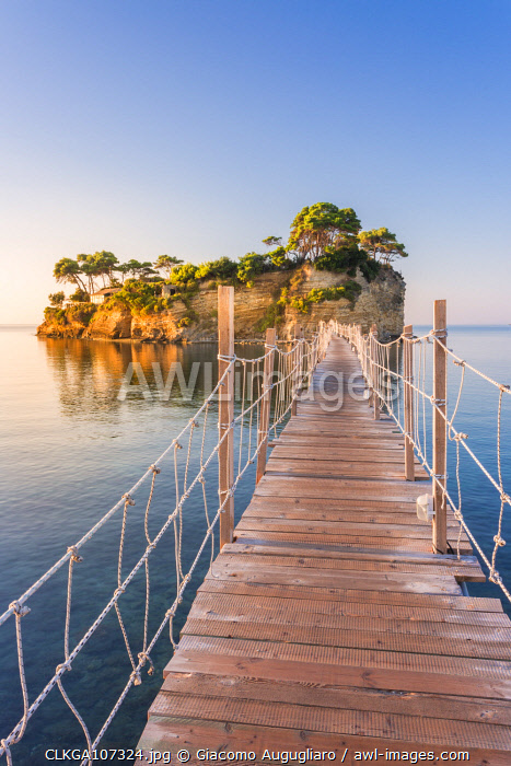 awl-images.com - Greece / Hanging wooden bridge over the sea leading to Cameo Island, Agios Sostis, Zakynthos, Ionian Islands, Greece