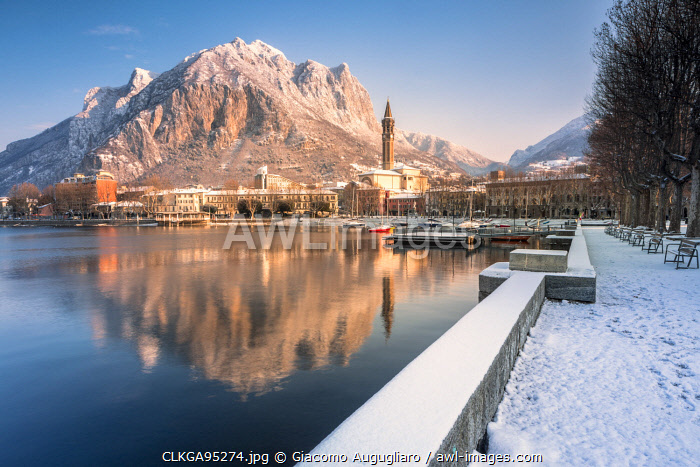 awl-images.com - Italy / Snowy lakefront of Lecco and San Martino Mountain reflected in Como lake, Lecco province, Lombardy, Italy