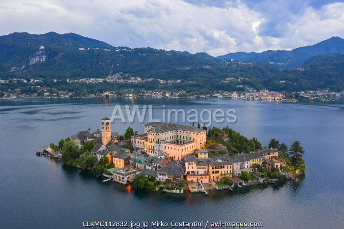 awl-images.com - Italy / Aerial view of Orta San Giulio and Lake Orta at blu hour before a storm. Orta Lake, Province of Novara, Piedmont, Italy.