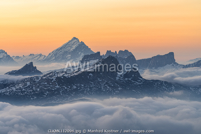 awl-images.com - Italy / Gran Cir, Gardena Pass, Dolomites, Bolzano district, South Tyrol, Italy, Europe. View just before sunrise from the summit of Gran Cir to the Mount Antelao