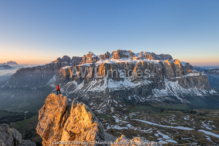 awl-images.com - Italy / Gran Cir, Gardena Pass, Dolomites, Bolzano district, South Tyrol, Italy, Europe. A mountaineer admires the sunrise at the summit of the Gran Cir (MR)