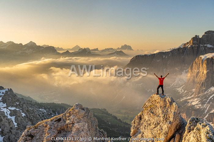 Gran Cir, Gardena Pass, Dolomites, Bolzano district, South Tyrol, Italy. A mountaineer on the summit of the Gran Cir (MR)