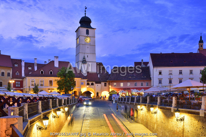 Old Town Hall Tower (Council Tower) and Piata Mica at dusk. Sibiu, Transylvania. Romania